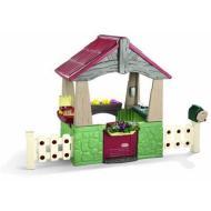 Casa con steccato e giardino